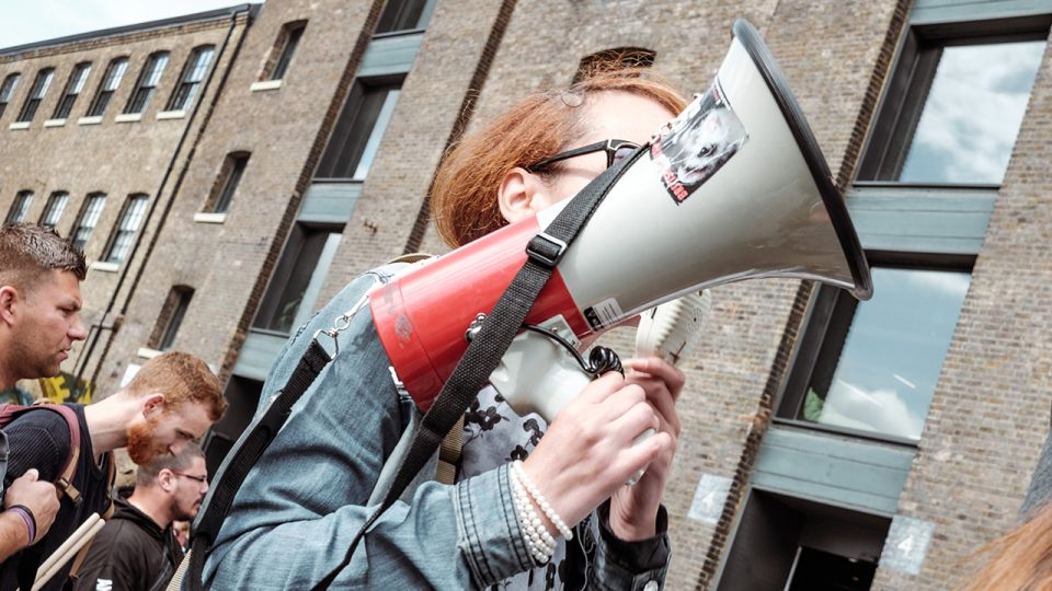An image of a female advocate talking through a megaphone