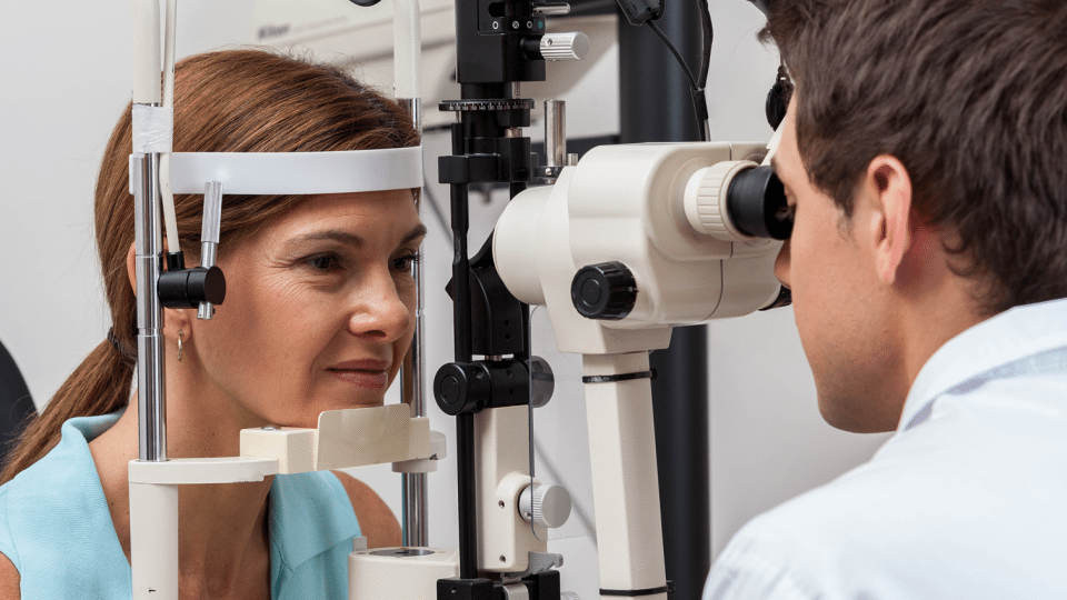 An ophthalmologist examines a young woman.