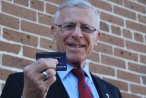 Ron Klein holding a credit card to show the magnetic strip